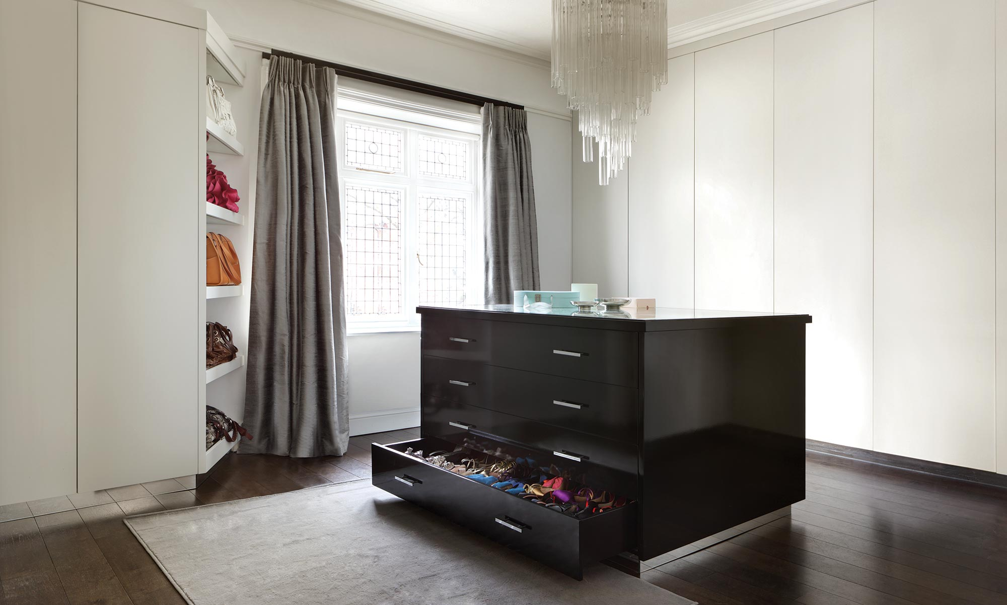Beautiful white and black gloss walk in wardrobe in a Chelsea residence