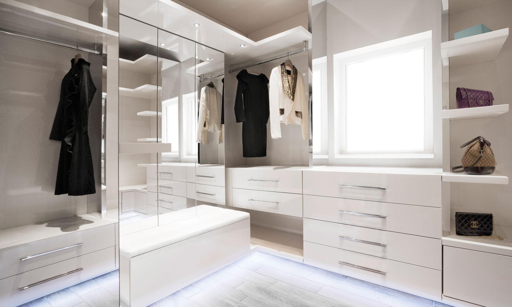 Beautiful, contemporary white gloss and glass walk in wardrobe, Chelsea