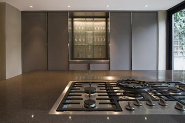 Handmade bespoke fitted kitchen in grey gloss finish and marble