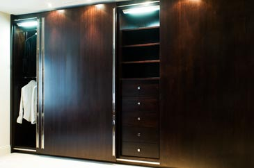 Fitted wardrobe in ebony with sliding doors