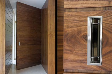Architectural Joinery showing feature door in Walnut and Chrome fittings